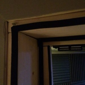 closeup photo of vocal booth door casing