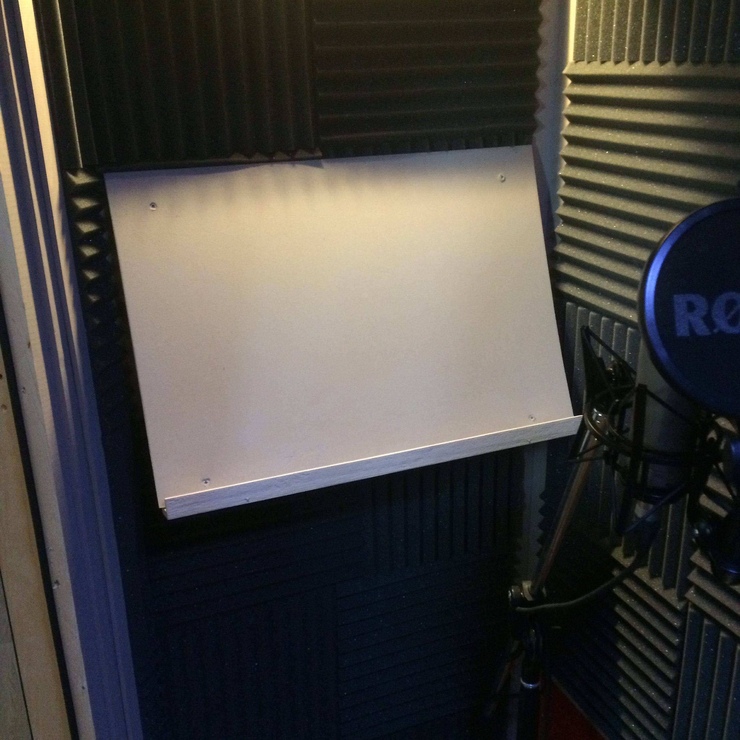 Script stand made from small MDF panel, mounted on a slight angle to the front wall of the booth.