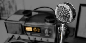 """Background image of old radio and microphone for Murrant """"Voice"""" page"""